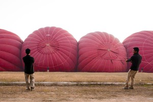 Bagan balloons being inflated in a disciplined line for a coordinated and exciting take off