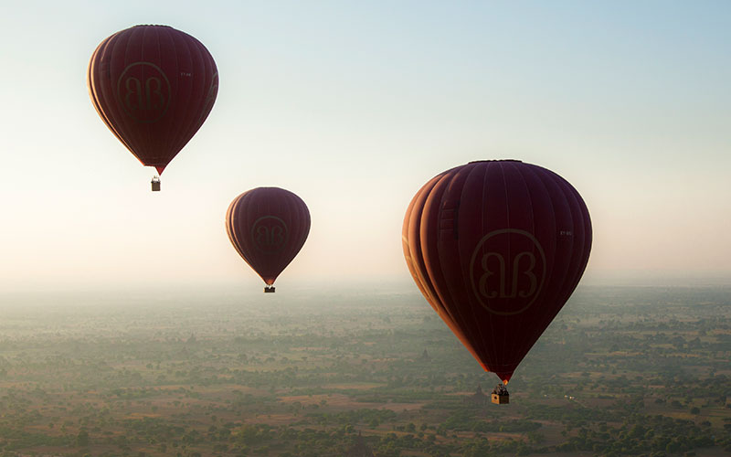 Riding the thermals as the balloons approach the over 8,000 pagodas of Bagan