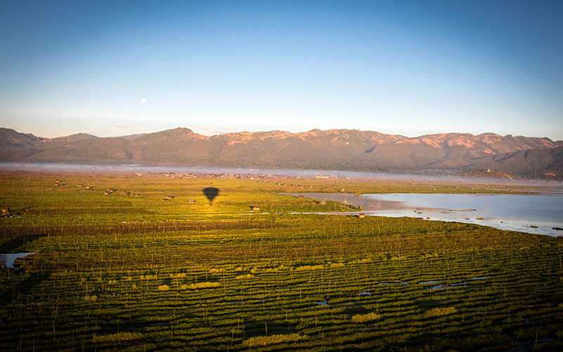 The shadow of the balloon over Inle indicates the height and clarity of the air
