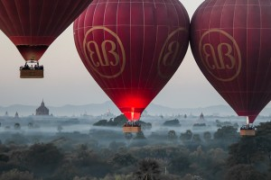 The spot of the first rays of sunlight in Bagan can be seen on the middle balloon