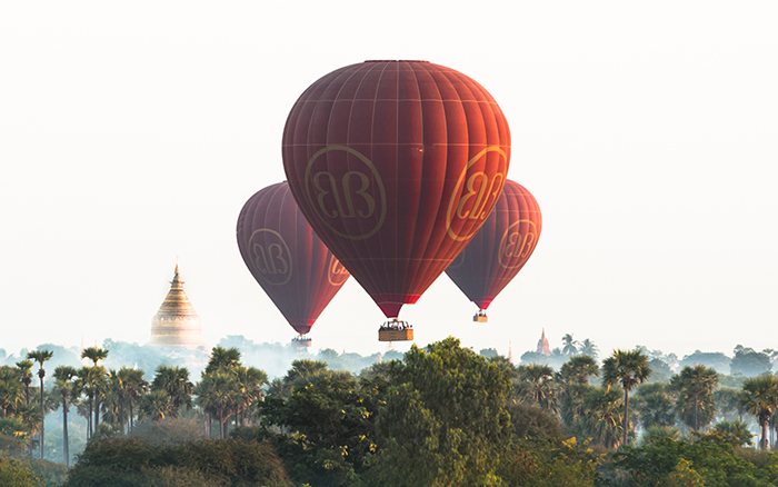 Flying towards the ancient pagodas of Bagan whilst below families are preparing for the day